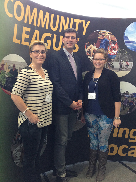 Jessica Mihaly, ECL secretary (left), and Alicia Staub, ECL social director (right), meet Edmonton's new mayor, Don Iveson, at the EFCL Leagues Alive! Conference.